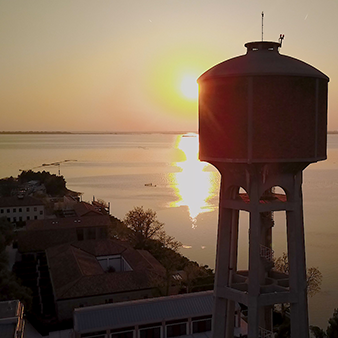 Water tower infront of sunset
