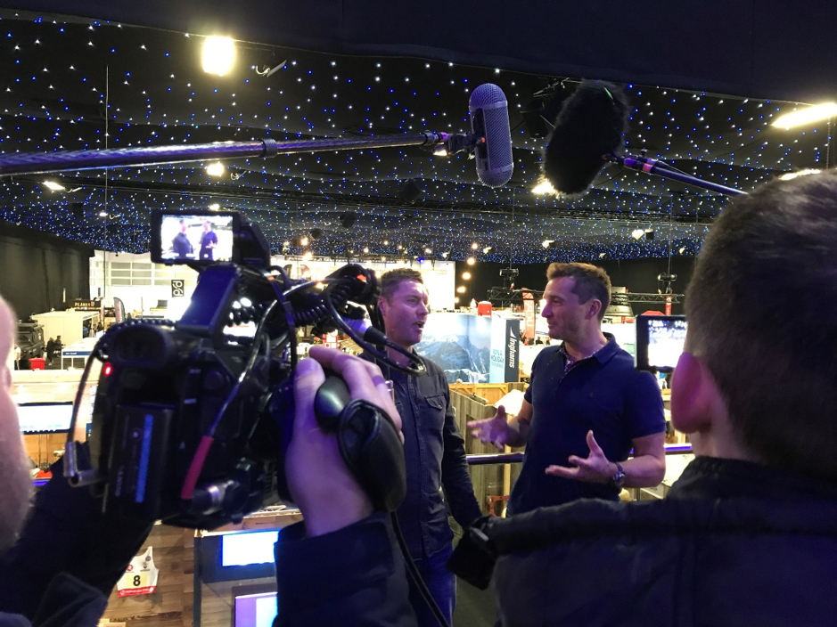 Two men doing an interview at an event